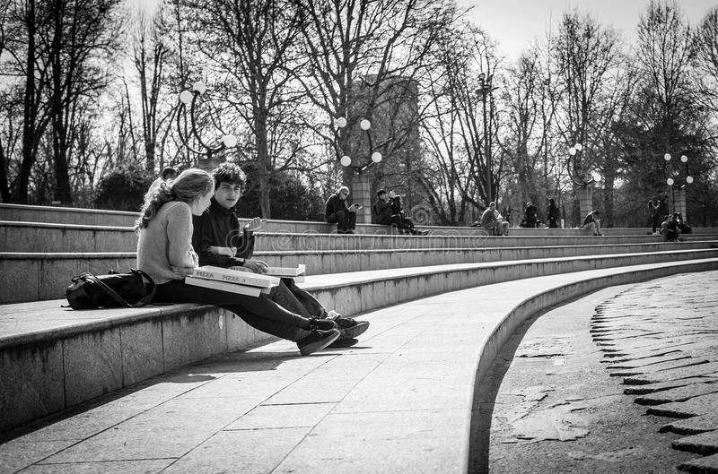 Milan, Italy - March 23, 2016: Young students sitting on the it stock photos