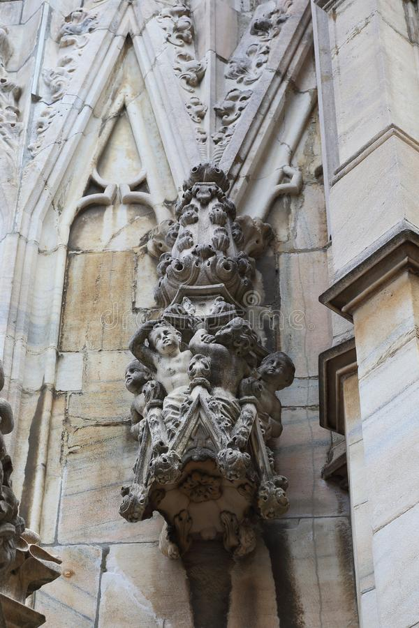 Fragment of the exterior decoration of the Milan Cathedral. MILAN, ITALY - MAY 17, 2018: This is one of many small sculptural ornaments on the roof of the Milan stock photography