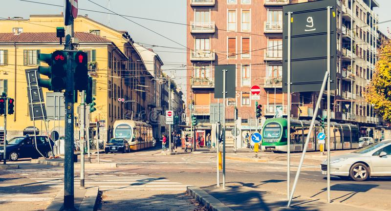 two tramway company Azienda Trasporti Milanesi stopped at a junction stock photo
