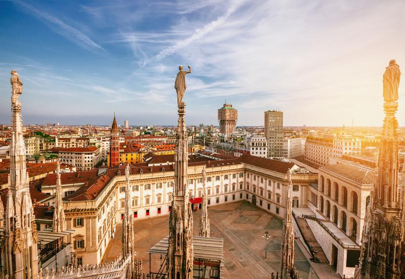 Milan, Italy panorama. View from Milan Cathedral at sunset. Palazzo Realle and Velasca Tower in the background stock images