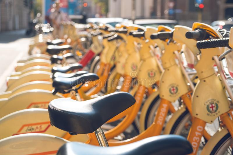 Milan, Italy - 14.08.2018: Rental and parking bicycles in the c royalty free stock images