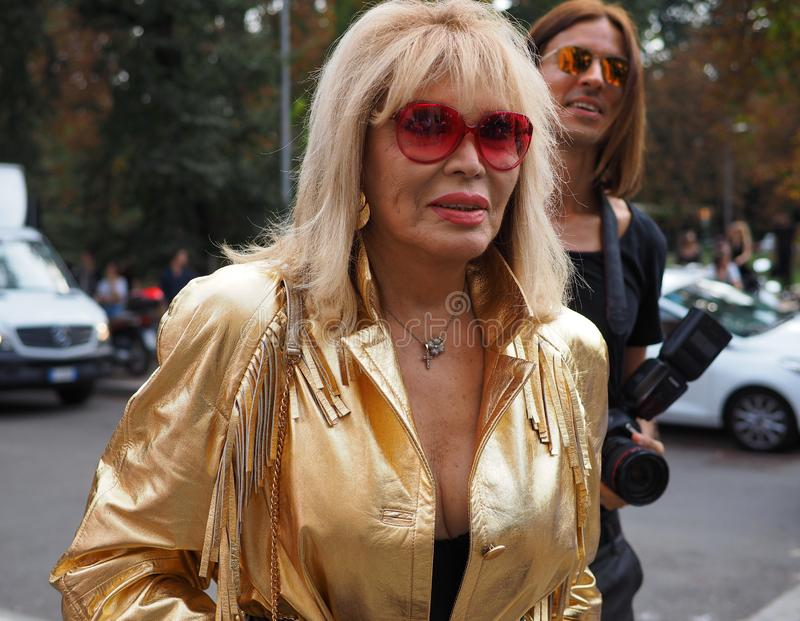 MILAN, Italy: September 22, 2018:AMANDA LEAR in the street. AMANDA LEAR in the street before Philosophy di Lorenzo Serafini fashion show during milano fashion stock photo