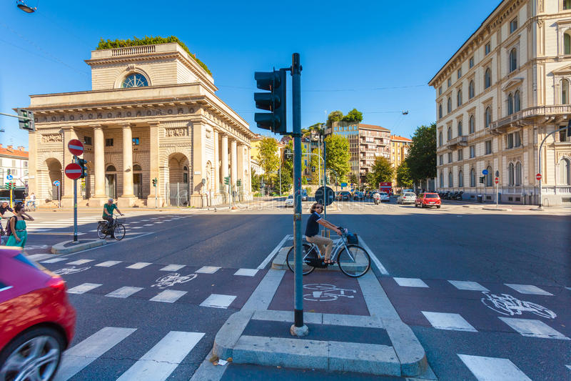 MILAN, ITALY - September 06, 2016: Bicyclistsare are waiting the green light of traffic light on the crossroad on Avenue Buenos A stock image