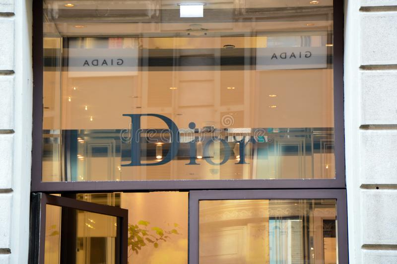 MILAN, ITALY - SEPTEMBER 7, 2017: Christian Dior store sign on the entrance, via Monte Napoleone, Milan royalty free stock images