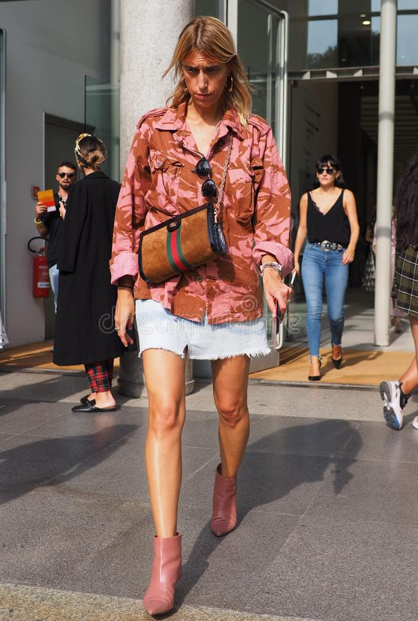MILAN, Italy: September 22, 2018: Fashionable woman street style outfit. Fashionable woman street style outfit after Philosophy di Lorenzo Serafini fashion show stock photo