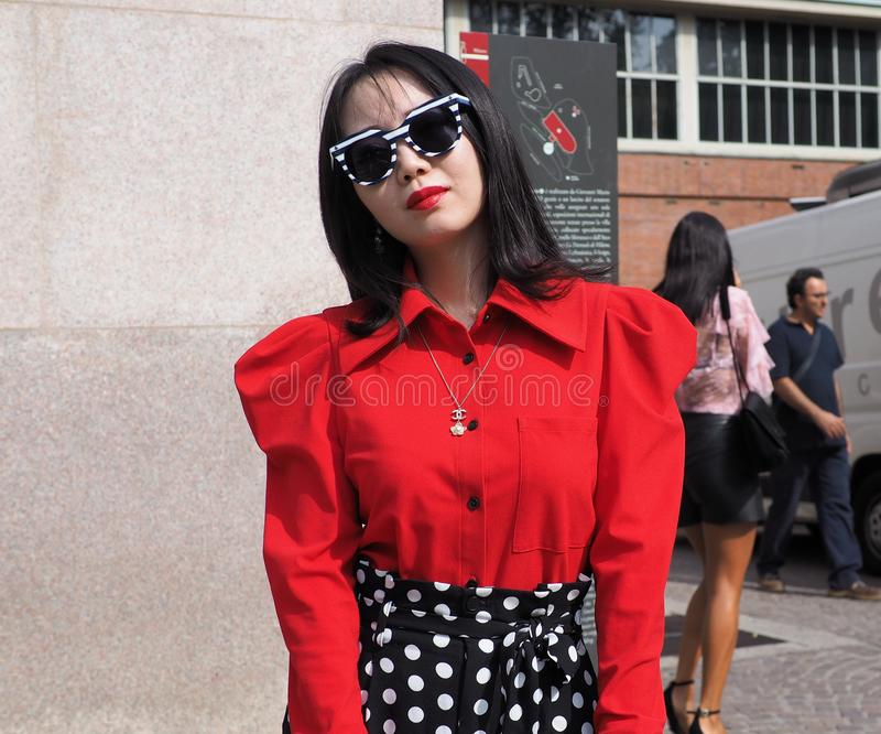 MILAN, Italy: 22 september 2018: Fashionable woman in streetstyle outfit. Fashionable asian woman street style outfit before Philosophy di Lorenzo Serafini stock image
