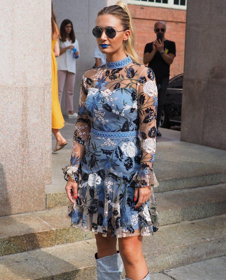 MILAN, Italy: 22 september 2018: Fashionable women in streetstyle outfit. Fashionable woman street style outfit before Philosophy di Lorenzo Serafini fashion royalty free stock photography