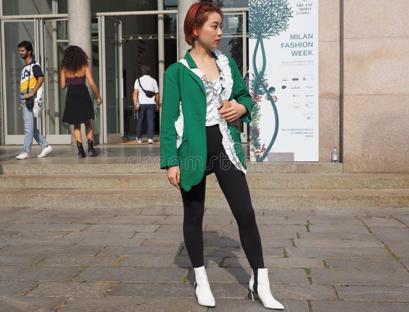 MILAN, Italy: 22 september 2018: Fashionable women in streetstyle outfit. Fashionable woman street style outfit before Philosophy di Lorenzo Serafini fashion royalty free stock images