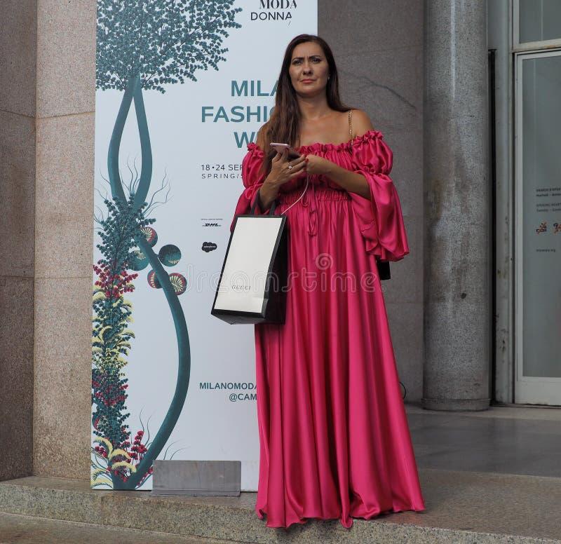 MILAN, Italy: 22 september 2018: Fashionable women in streetstyle outfit. Fashionable woman street style outfit before Philosophy di Lorenzo Serafini fashion royalty free stock photo