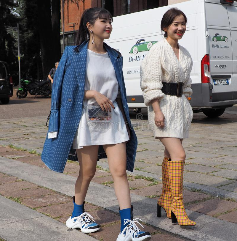 MILAN, Italy: 22 september 2018: Fashionable women in streetstyle outfit. Fashionable women street style outfit before Philosophy di Lorenzo Serafini fashion royalty free stock photos