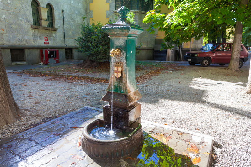 MILAN, ITALY - September 06, 2016: Fountain with drinking water in the street of Milan. royalty free stock photography