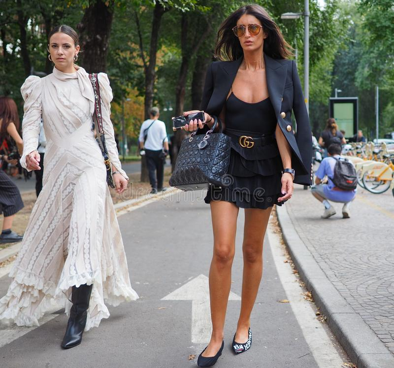 MILAN, Italy: 23 September 2018: Models in street style outfit before Armani Fashion show. Models in street style outfit before Philosophy by Lorenzo Serafini stock photo