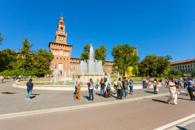 MILAN, ITALY - September 07, 2016: View on the Fountain of Piazza Castello Piazza Castello Springbrunnen and the Tower royalty free stock photos