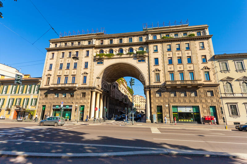 MILAN, ITALY - September 06, 2016: View on the old building with arch, columns and balconies with flowers stock image