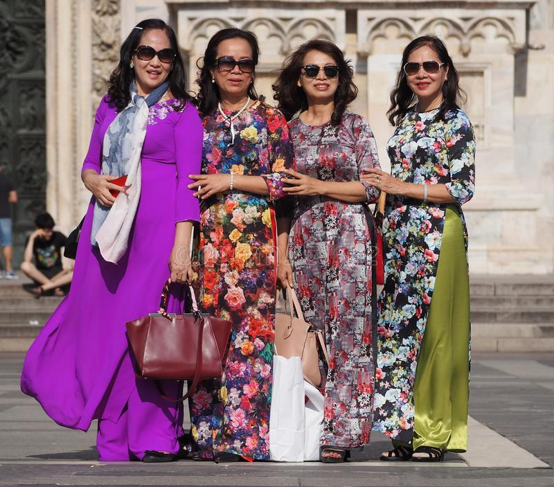 MILAN - JUNE 1, 2018: Fashionable asian woman posing for photographers in Duomo square during fashion street event stock photo