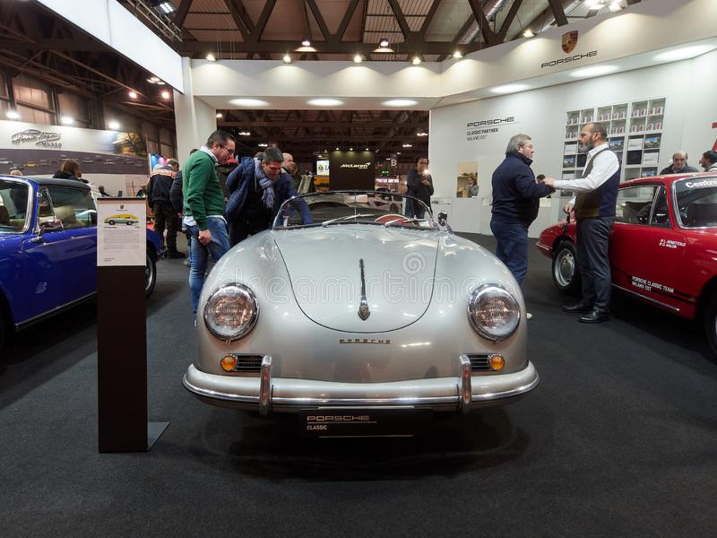 Milan, Lombardy Italy - November 23 , 2018 - Visitors of Autoclassica Milano 2018 edition contemplate a classic silver Porsche 356 stock images