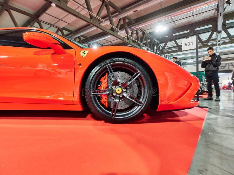 Milan, Lombardy Italy - November 23 , 2018 - Visitors of Autoclassica Milano 2018 edition take photos at Ferrari 458 stock photo