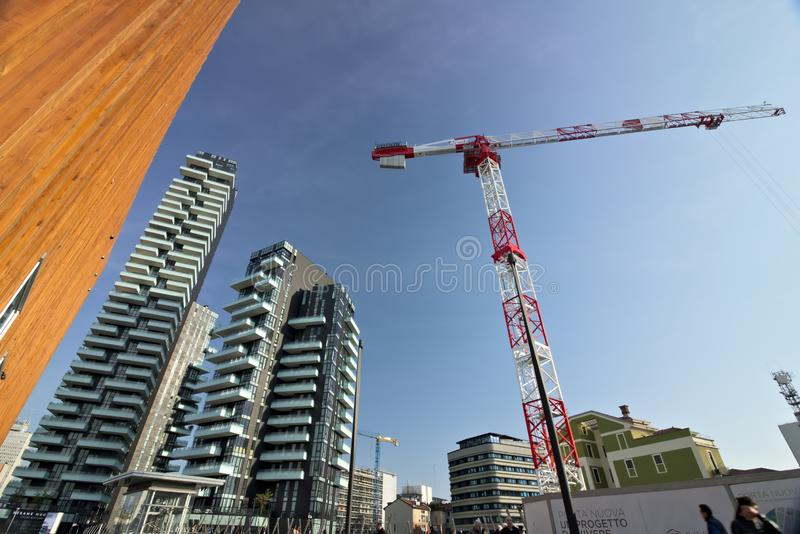 Milan. March 21 2019. Tower crane moving on a construction site in the Business District near the Torre Solaria. Tower crane moving on a construction site in the stock photography