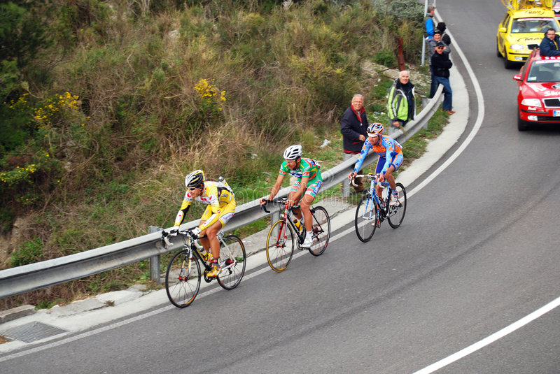 Milan-Sanremo Cycle Race 2008. Three cyclists (Savini, Frishkorn and Belohvosciks) in the famous and international cycle race Milano-Sanremo 99° edition stock photography