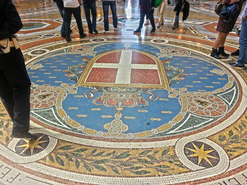 Galleria Vittorio Emanuele II of Milan: octagon Sabaudo coat of arms stock image