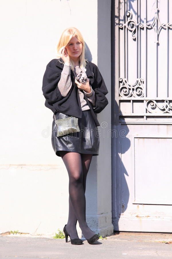 Milan streetstyle city fashion leather skirt royalty free stock image