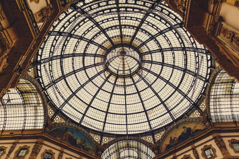 Architecture of the Galleria Vittorio Emanuele II arcade near Piazza del Duomo in Milan`s city centre and main shopping district. MILANO, ITALY - December 5th royalty free stock images
