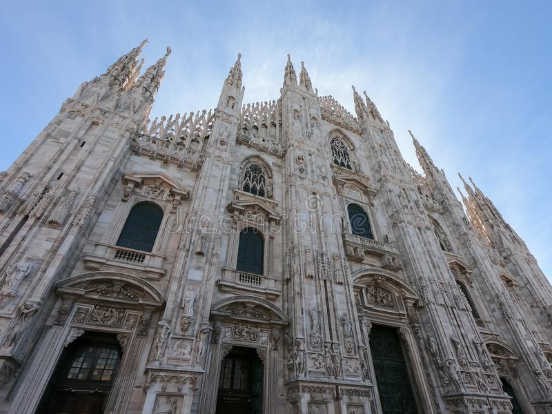 Milano, Italy. The main facade of the Cathedral called Duomo. The church is dedicated to St Mary of the Nativity. Milano, Italy. The main facade of the Cathedral stock images