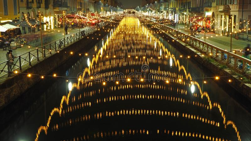 Milano, Italy. The Naviglio Grande canal waterway with Christmas light, night view. This district is famous for restaurants, pubs. And nightlife stock photos