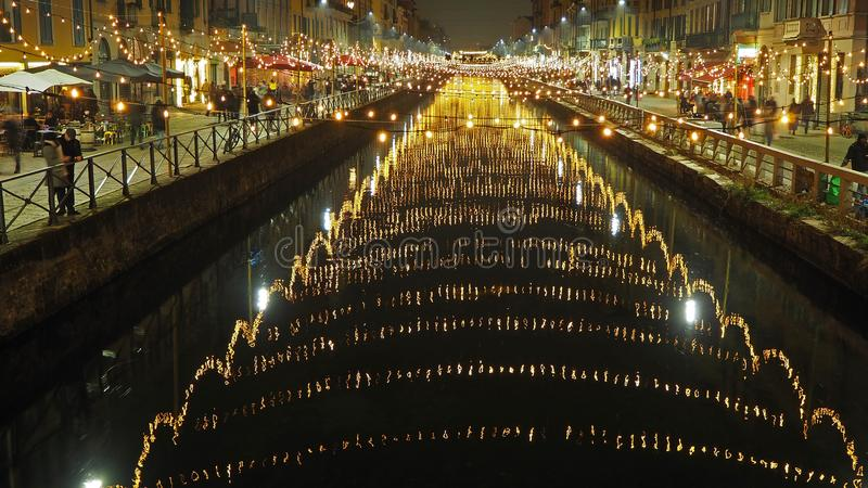 Milano, Italy. The Naviglio Grande canal waterway with Christmas light, night view. This district is famous for restaurants, pubs. And nightlife stock images