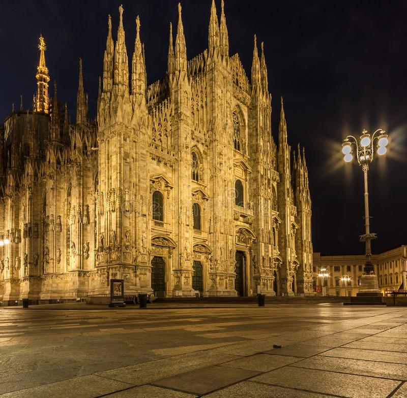Milano piazza duomo cathedral front view at night stock image