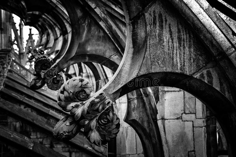 Details of Duomo Cathedral of Milan rooftop gothic architecture. Details of a marble architecture of the Milan  Duomo's rooftop.Black and white photography royalty free stock image