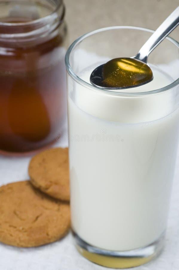 Milch und Honig lizenzfreie stockbilder