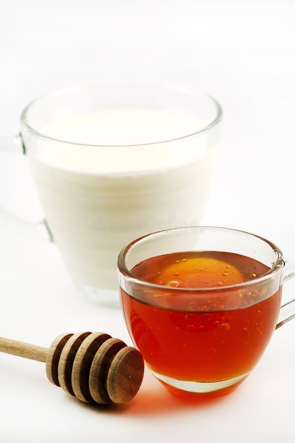 Milch und Honig stockbild