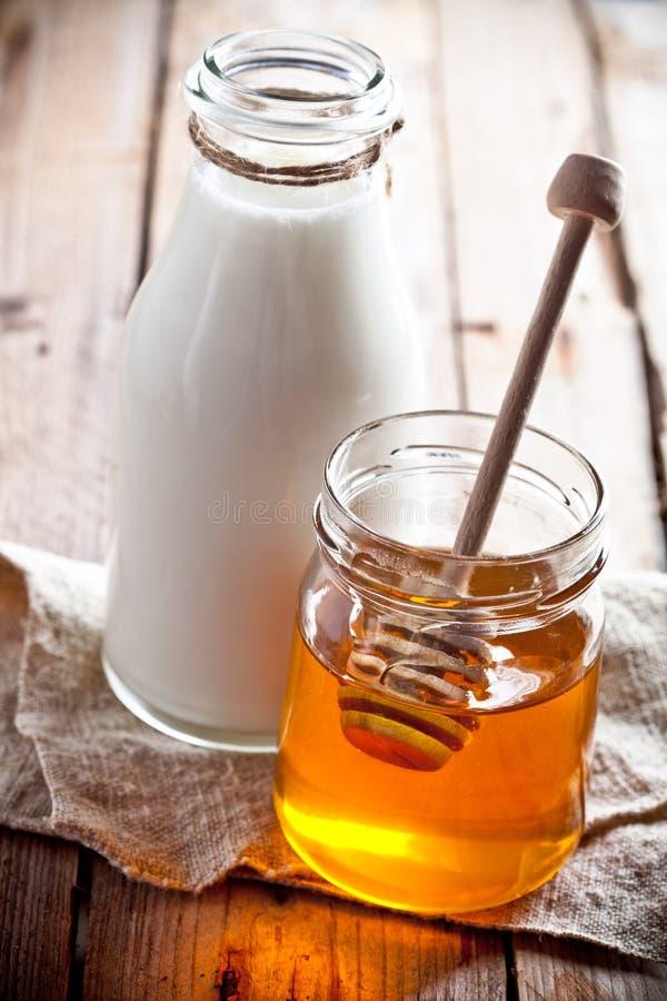 Milch und Honig lizenzfreies stockbild