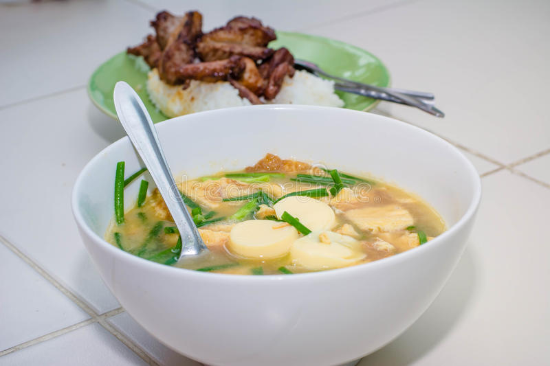 Mild soup with vegetables, Tofu and pork stock image