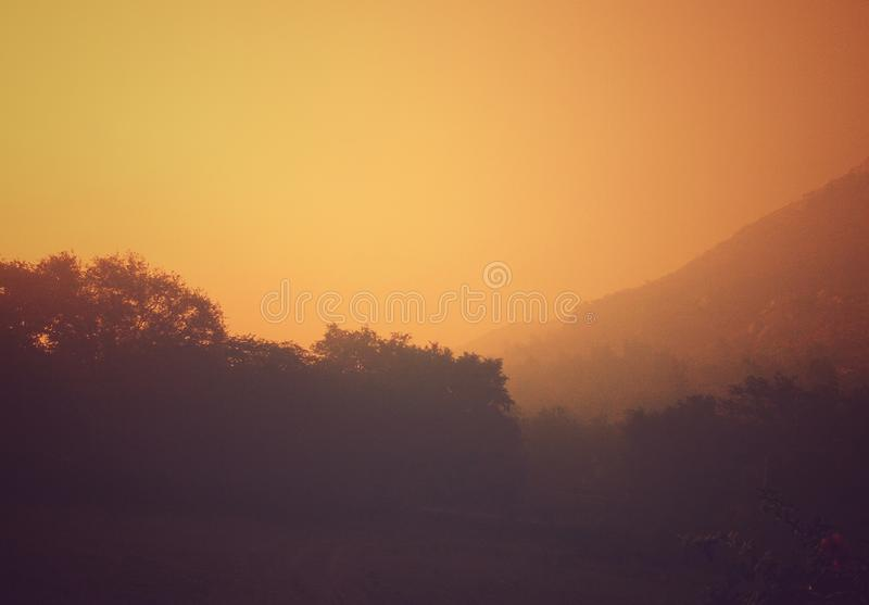 A mixture of mild morning fog and sunrise colors created a beautiful picture stock photography