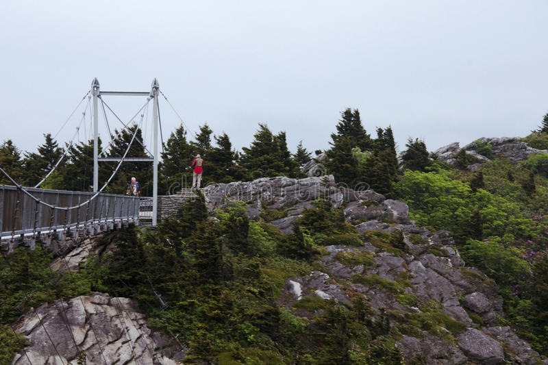 Mile High Bridge spans a chasm atop Grandfather Mountain in Western North Carolina. Tourists trek across the Mile High Bridge which spans a chasm atop royalty free stock image