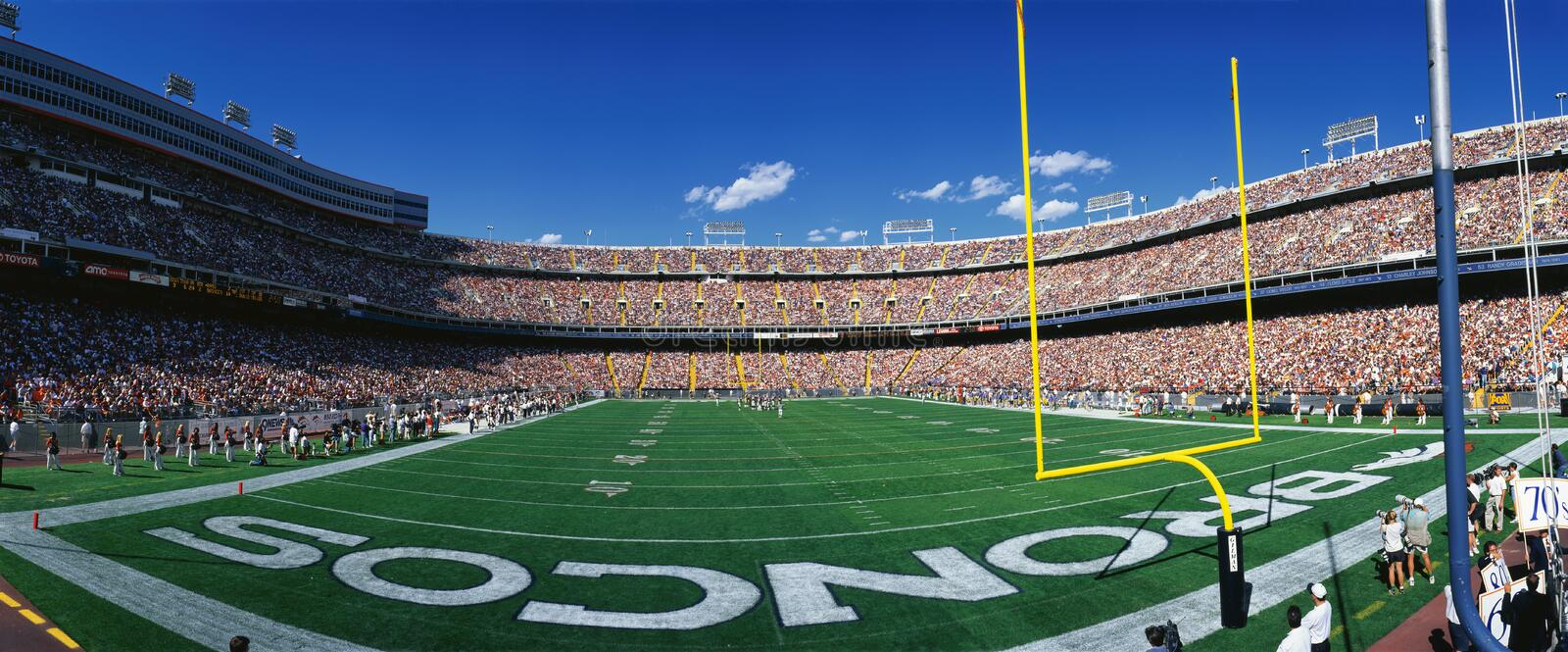 Mile High Stadium. This is Mile High Stadium and the game is the Denver Broncos vs. the St. Louis Rams. It is a sold out NFL game that took place on 9/14/97