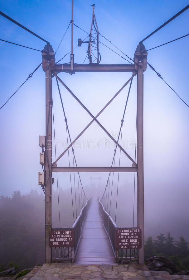 The Mile-High Swinging Bridge in fog, at Grandfather Mountain, N. Orth Carolina stock photos