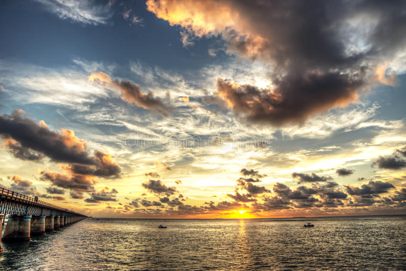 7 Mile Bridge Sunset - Key West - Florida Keys. Capturing that moment when the sun just touches the horizon as it brings an end to another day in paradise royalty free stock images