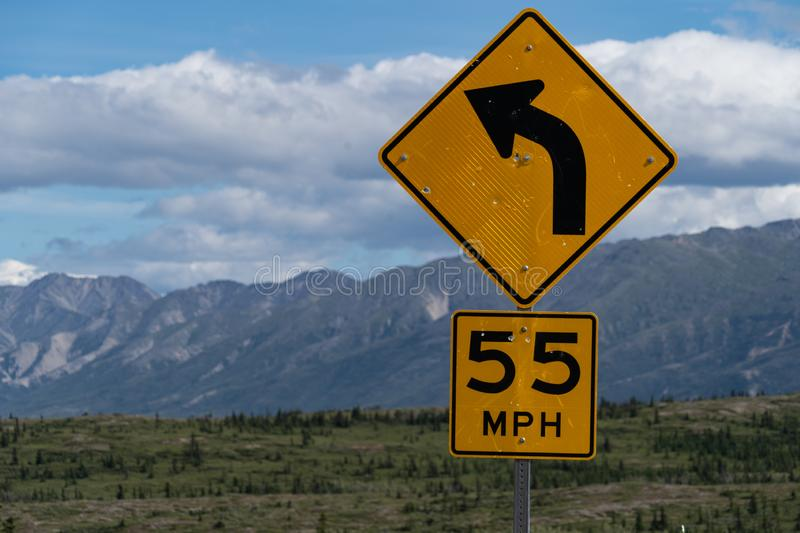 55 miles per hour speed limit on curve sign on a United States h stock image
