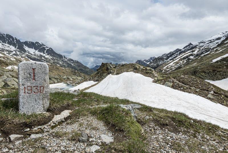 Milestone in the alps royalty free stock photo