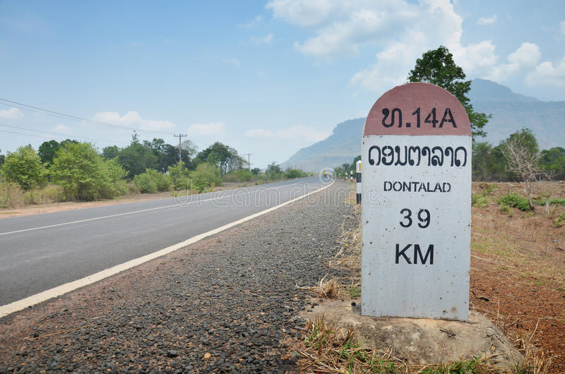 Milestone go to DONTALAD at Pakse in Champasak, Laos. A milestone is one of a series of numbered markers placed along a road or boundary at intervals of one mile stock photo