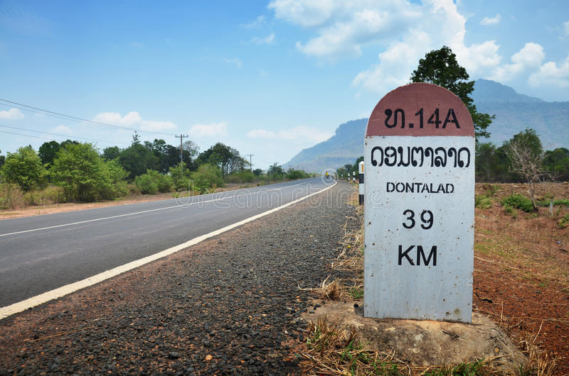 Milestone go to DONTALAD at Pakse in Champasak, Laos stock photography