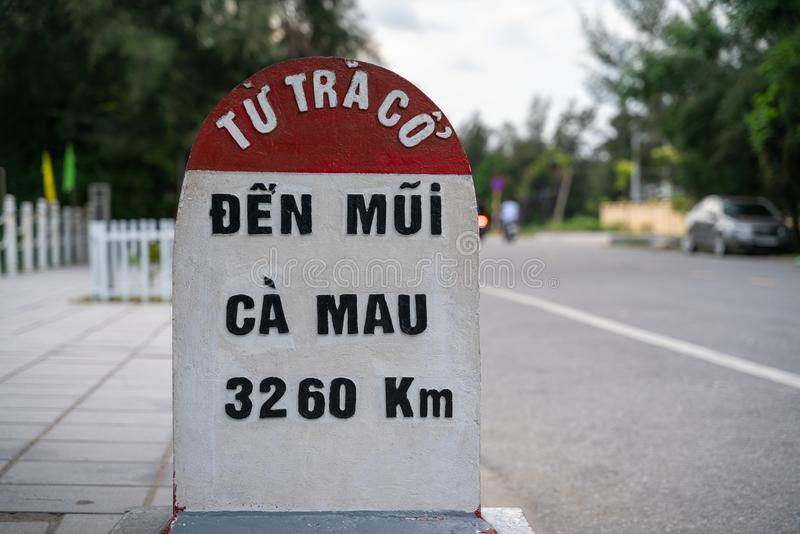 Milestone at Tra Co beach in Mong Cai, Quang Ninh, Vietnam.  royalty free stock images