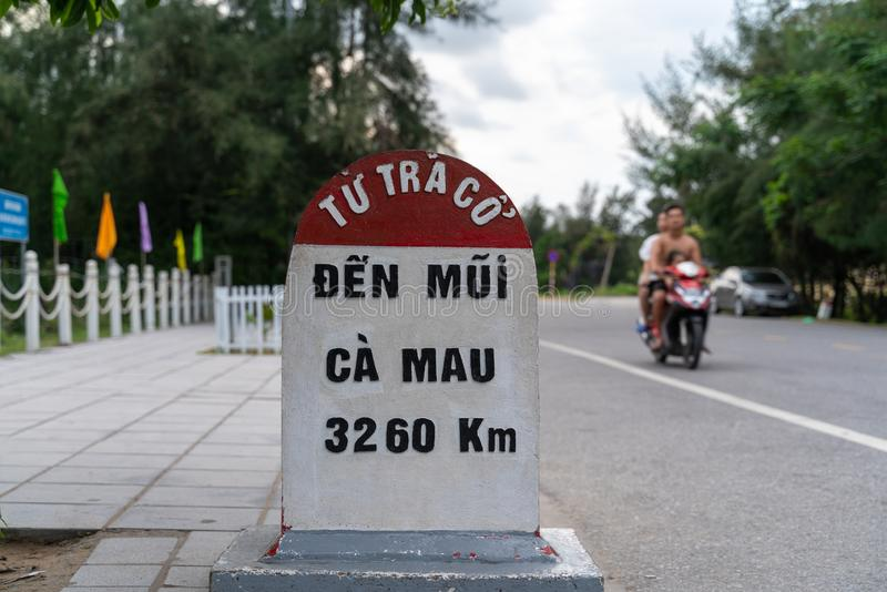 Milestone at Tra Co beach in Mong Cai, Quang Ninh, Vietnam.  royalty free stock photo