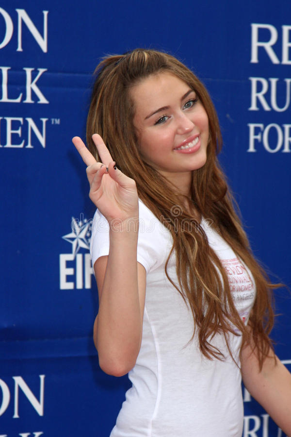 Miley Cyrus. Arriving at the Revlon Run/Walk for Women at the Los Angeles Coliseum in Los Angeles , CA on May 9, 2009 2009 Kathy Hutchins / Hutchins Photo stock photos