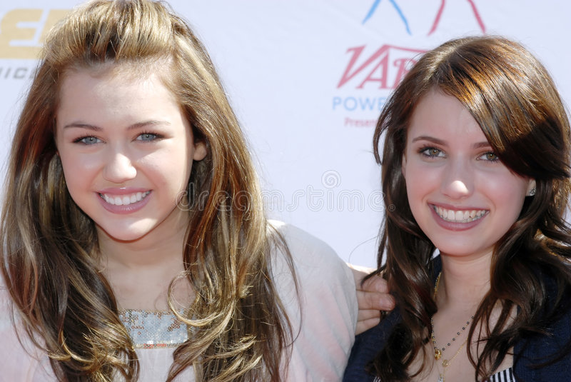 Miley Cyrus and Emma Roberts stock image