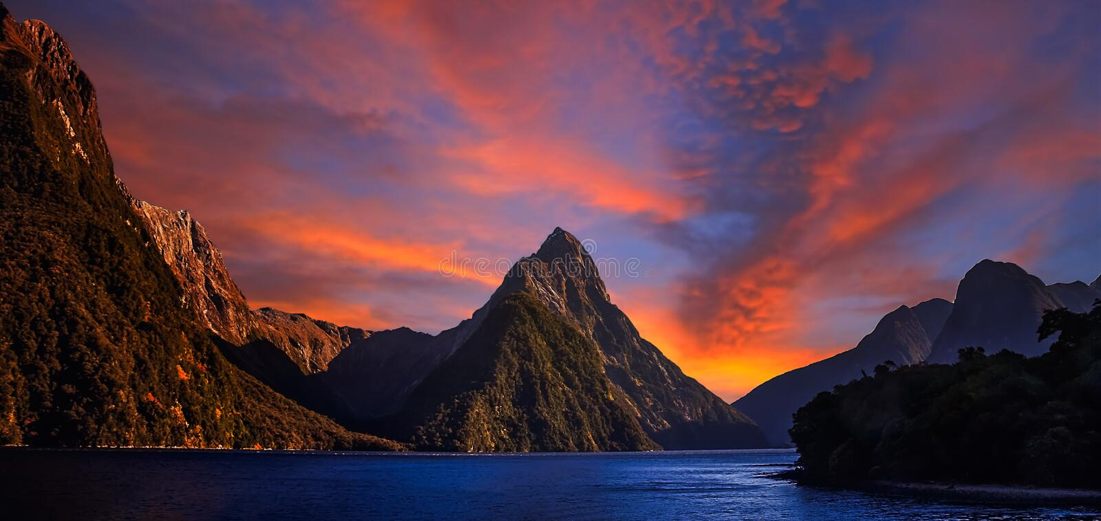 Milford Sound at dawn. Sunrise at Milford Sound in New Zealand stock images