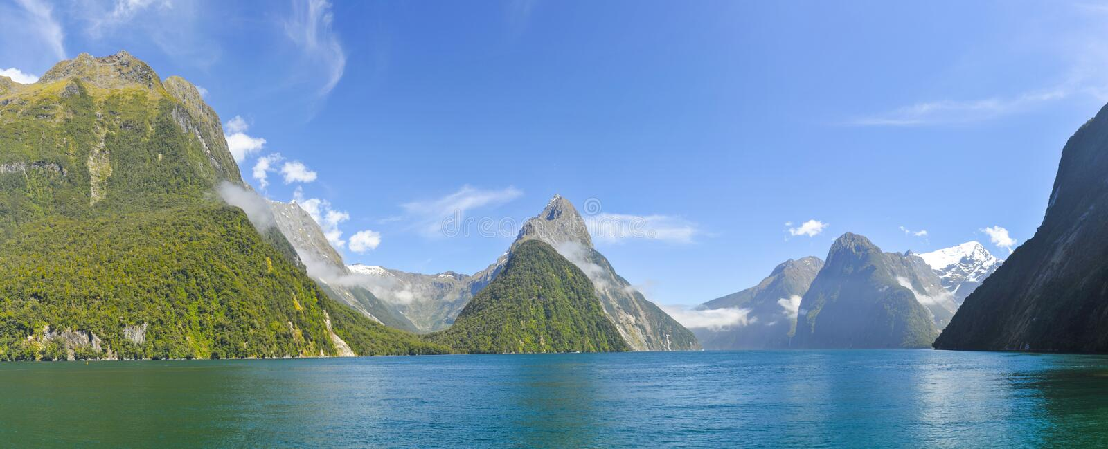 Milford Sound. Famous Mitre Peak rising from the Milford Sound fiord. Fiordland national park, New Zealand. Panoramic photo royalty free stock image